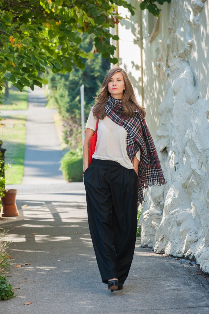 woman in black pants and colorful scarf