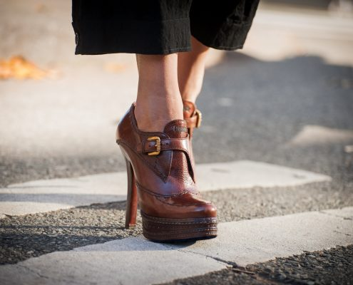 person walking in Prada platform shoes.